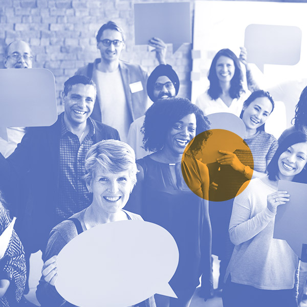 Diverse group of people holding up blank cardboard cards shaped like speech bubbles
